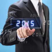 Businessman touching and choosing new year 2015 on virtual screen