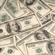 Is the Boss Making a Million? | background dollar bills